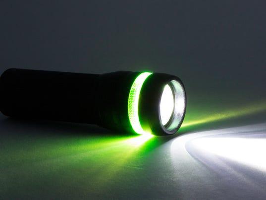 Black Flashlight, Beam from flashlight on a paper