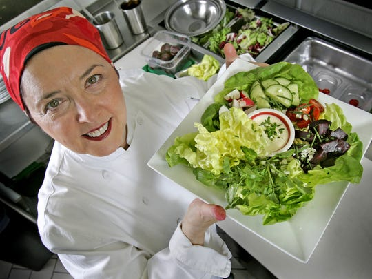 Within the kitchen at R-Bistro, chef, Regina Mehallick poses with her freshly made traditional Irish salad in 2011.