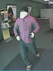 Police released images Friday of a Check 'n Go robbery