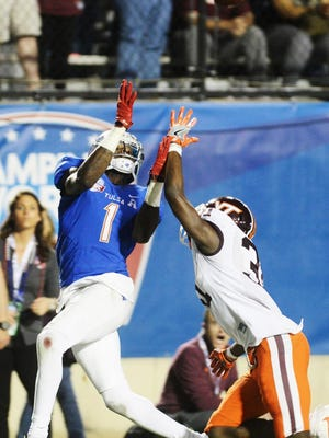 Tulsa's Keyarris Garrett reaches for a catch during the Camping World Independence Bowl.