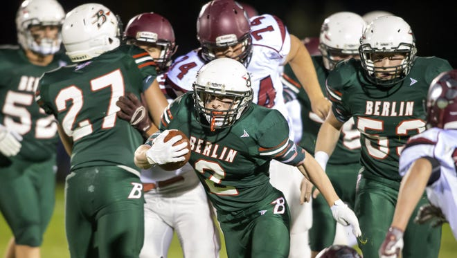 Berlin's Jack Werch (2) ran for 215 yards and a pair of touchdowns in Berlin's 21-14 win over Winneconne on Friday night, Oct. 7, 2016.