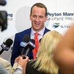 Denver Broncos quarterback Peyton Manning, speaks with