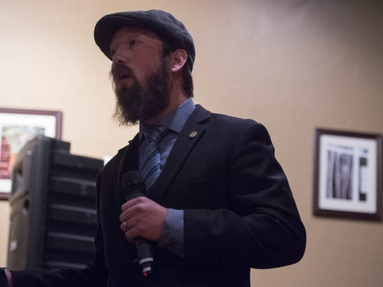 Ryan Wallace, owner of William Oliver's, speaks during the Coloradan Storytelling event at William Oliver's Publick House Thursday, December 10, 2015.