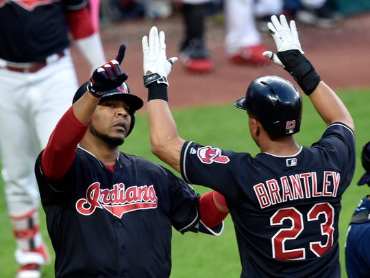 Cleveland Indians designated hitter Edwin Encarnacion (10) celebrates his two-run home run with left fielder Michael Brantley (23) in the sixth inning against the Tampa Bay Rays at Progressive Field.