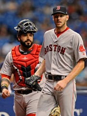 Boston Red Sox catcher Sandy Leon, left, and starter