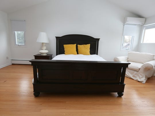 The master bedroom at  5 Washington Avenue is one of five houses being sold by Rosie O'Donnell in South Nyack.