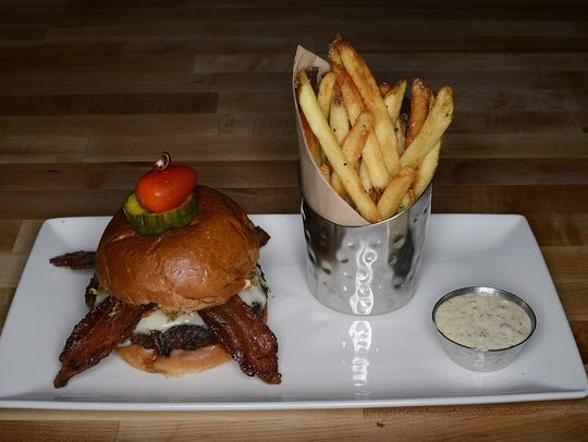 The 1919 burger is topped with havarti, fried sauerkraut,