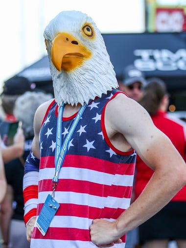 Spectators wear patriotic and race-themed fashion before