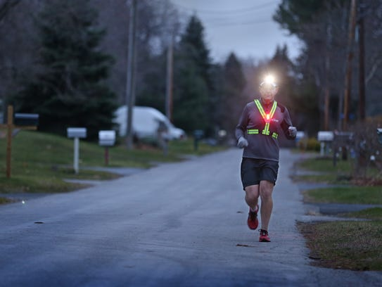 Mark Sands wears his reflective belts and flashing