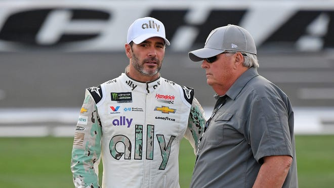 May 23, 2019; Concord, NC, USA; NASCAR Cup Series driver Jimmie Johnson (L) talks with his car owner Rick Hendrick (R) during qualifying for the Coca-Cola 600 at Charlotte Motor Speedway. Mandatory Credit: Jasen Vinlove-USA TODAY Sports ORG XMIT: USATSI-403498 ORIG FILE ID:  20190523_jfv_bv1_044.jpg