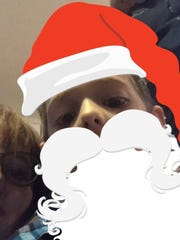 Miles Doyle as Santa from the sELFies feature on the Santa Tracker App.
