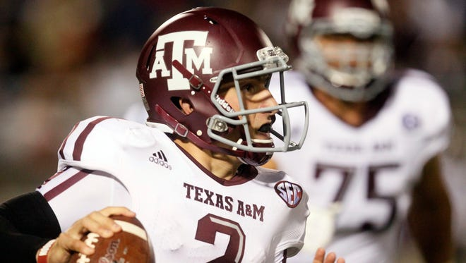 T Jake Matthews (75) watched Johnny Manziel for three years at Texas A&M.