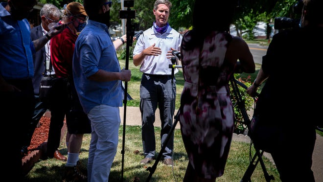 U.S. Rep. Rodney Davis, R-Taylorville, answers reporters' questions Friday after delivering face shields made by John Deere to Aperion Care in Springfield.