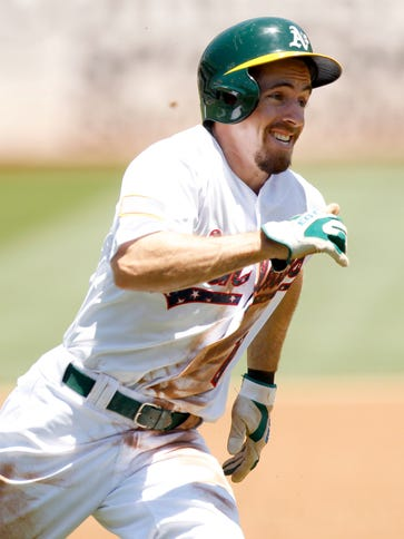 Oakland Athletics outfielder Billy Burns (1) rounds