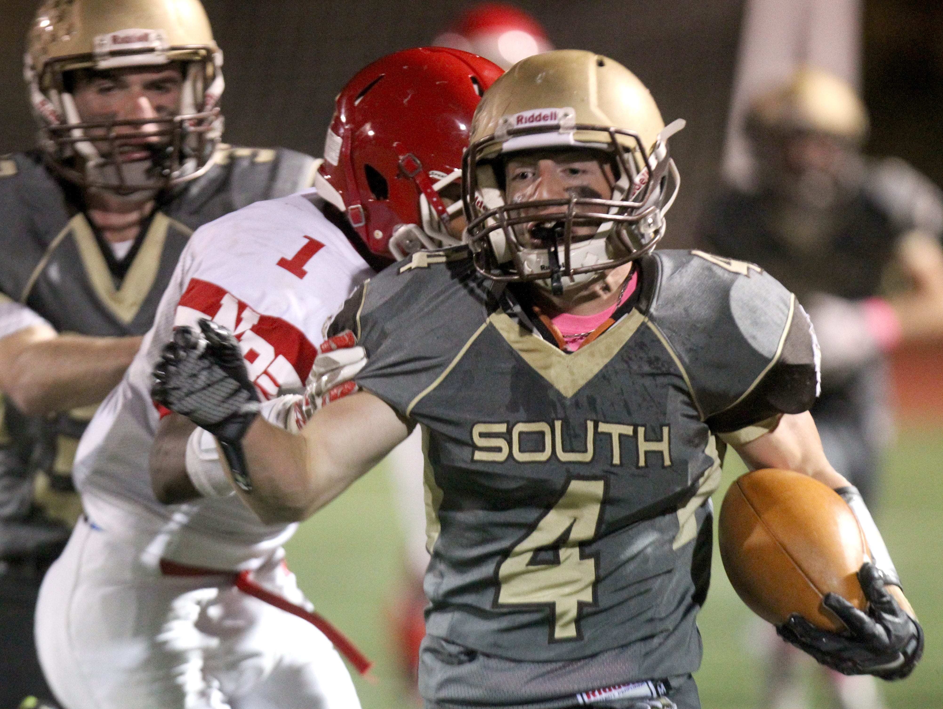 Clarkstown South's Kyle Samuels breaks past North Rockland's Lamar Seward during their Class AA qualifying-round game at Clarkstown South on Oct. 16, 2015. Samuels is one of 25 finalists for The Journal News/lohud 2016 Super 11.