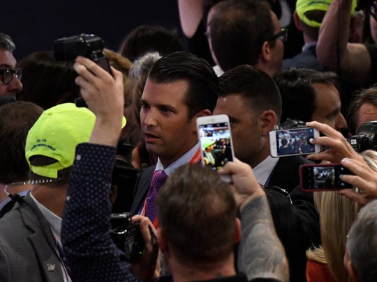 Donald Trump Jr. makes his way through the crowd after announcing New York's roll call vote, effectively securing the GOP nomination for his father, Donald Trump, during the 2016 Republican National Convention at Quicken Loans Arena in Cleveland July 19, 2016.