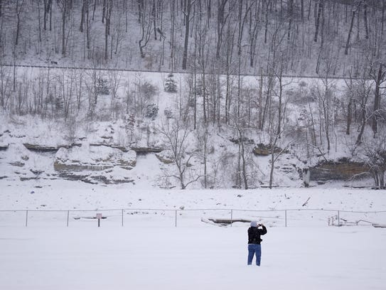 Pam Britton looks at the ice jam on the Muskingum River