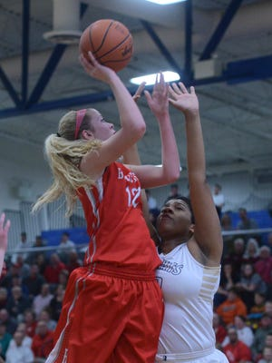 Bellevue's Tara Rinner puts up a shot as she is pressured by Archibishop Akron Hoban's Nora Minter during the first half of the Div II regional semi-final at Ontario High School on Tuesday, Mar 10, 2015.
