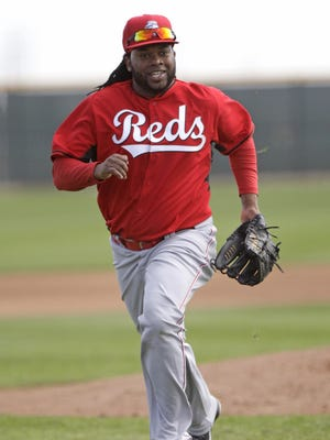Reds pitcher Johnny Cueto runs towards home plate during infield practice Thursday morning.