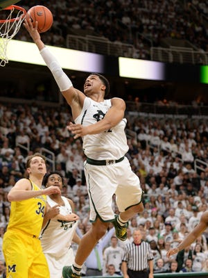 Freshman forward/guard Miles Bridges goes up to the basket during the game against Michigan on Sunday, Jan. 29, 2017 at the Breslin Center. Michigan State won, 70-62.