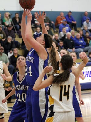 Kendra Dombrowsk, center, is one reason why the Amherst girls basketball team is ranked in Division 4 in teh Associated Press state poll this week.