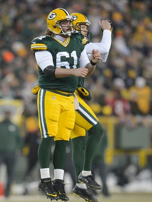 Green Bay Packers kicker Mason Crosby (2) does an air bump with long snapper Brett Goode (61) after a field goal against the Atlanta Falcons during Monday night's game at Lambeau Field.
