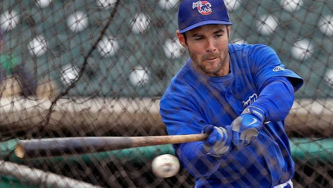 Iowa Cubs outfielder Matt Szczur takes a swing in the cage in 2014.