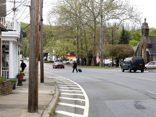A man crosses the street near the Sloatsburg Library