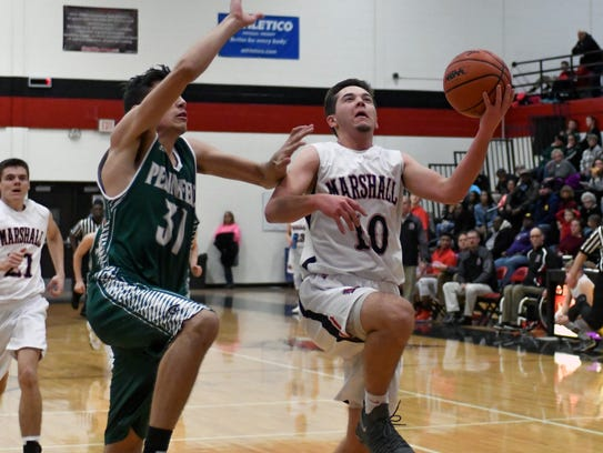 Marshall's Wyatt Crow (10) drives the basket during
