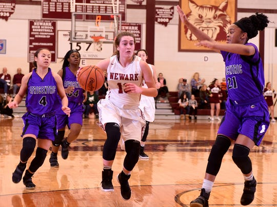 Newark senior Emily Paul dribbles in the open court Feb. 1 during a 65-50 victory against Africentric.