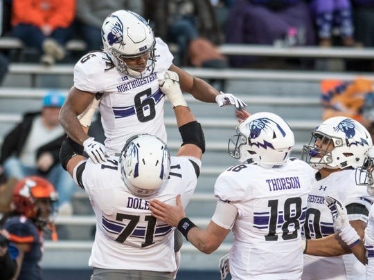 Northwestern offensive lineman Tommy Doles (71) lifts wide receiver Jelani Roberts (6) in the air after Roberts ran for a touchdown during the second quarter of an NCAA college football game against Illinois, Saturday, Nov. 25, 2017, at Memorial Stadium in Champaign, Ill. (AP Photo/Bradley Leeb)