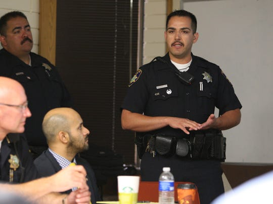 Salinas police Officer Raul Rosales speaks about the Community Alliance for Safety and Peace during a meeting Tuesday in the West Wing Conference Room of Salinas City Hall.