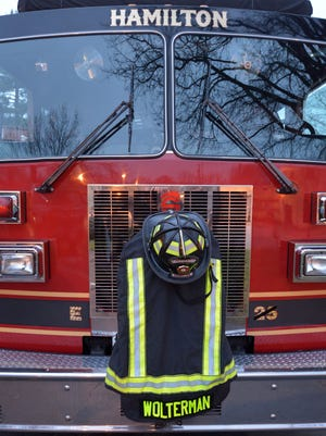 Services are conducted for fallen Hamilton firefighter Patrick Wolterman, 28, December 31 in Liberty Township.
