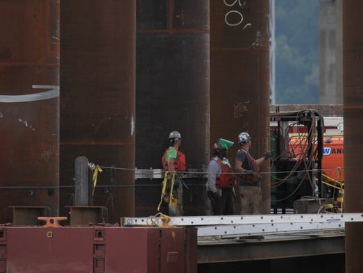 Contractors work alongside pilings May 30, 2014 at the site of the new Tappan Zee Bridge construction.