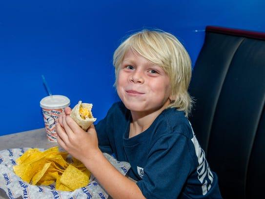 Charlie Moren enjoys his favorite burrito at Surf Taco.