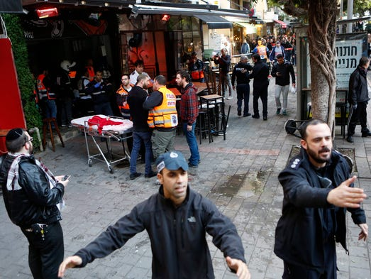 Israeli police clear the scene of a shooting attack