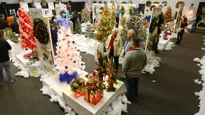 More than 200 trees and other holiday decorations sold at auction during Friday's Festival of Trees at the Muskingum County Welcome Center.