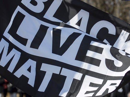 A Black Lives Matter Flag was raised outside Burlington