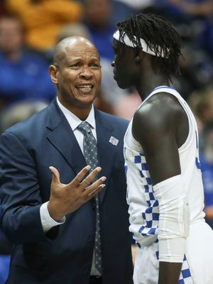 UK assistant coach Kenny Payne talks with Wenyen Gabriel during the Sweet Sixteen game against Kansas State Thursday, March 22, 2018 in Atlanta.