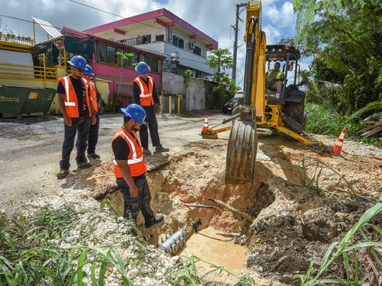 Guam Waterworks Authority employees conduct repairs to a six-inch main waterline and a two-inch to one-inch pipe reduction, along Asardas Drive in Yigo, on Wednesday, April 4, 2018. Water service to residents and businesses in the surrounding area was restricted until the crew was able to complete the repairs.