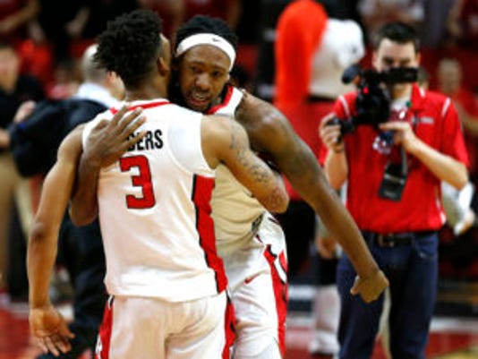 Mar 4, 2017; Piscataway, NJ, USA; Rutgers Scarlet Knights guard Corey Sanders (3) and forward Deshawn Freeman (33) celebrate after defeating Illinois Fighting Illini 62-59 at Louis Brown Athletic Center. Mandatory Credit: Noah K. Murray-USA TODAY Sports