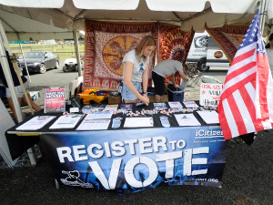 Macy Nix and Evan Rose get ready to register voters at the Lockn' Music Festival.  Both spent the summer traveling to music festivals with HeadCount.  (H. Darr Beiser, USA TODAY staff)