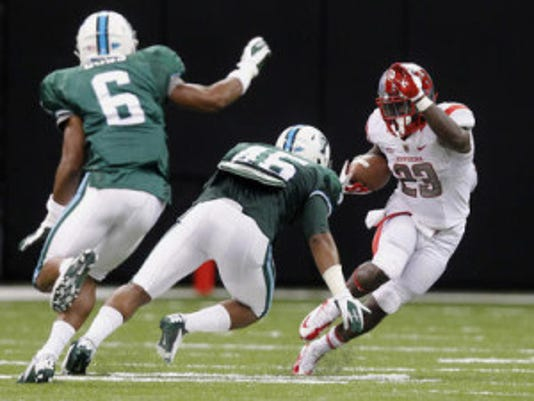 Former Rutgers halfback Jawan Jamison dances around tackles during a matchup with Tulane in 2012. (Chuck Cook/US Presswire)