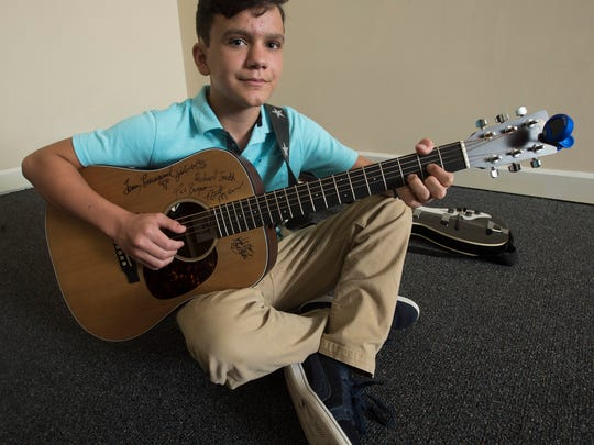 Ben Kennington, 12, submitted an original composition to win a music scholarship from Stevenson Klotz Law Firm through the Youth Music Project.