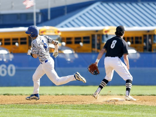 Mike Limoncelli rounds second in front of Corning shortstop