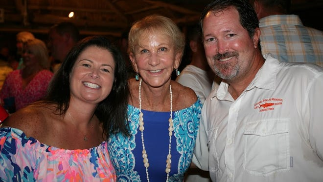 Tanya Windecker, Sooky Shields and Shaun Plymale attend the Michael Shields Memorial Inshore Open on Sept. 29 at River Palms Cottages, where guests enjoyed a paella dinner, drinks, dancing, a silent auction, all while raising funds and learning about the programs at Project L.I.F.T. that serve young men and women.