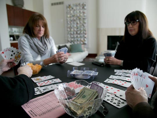Left to right: Carol Sofen, 63, of West Bloomfield and Cathy Jurist, 60, of Bloomfield Hills play Canasta, a regular tradition.