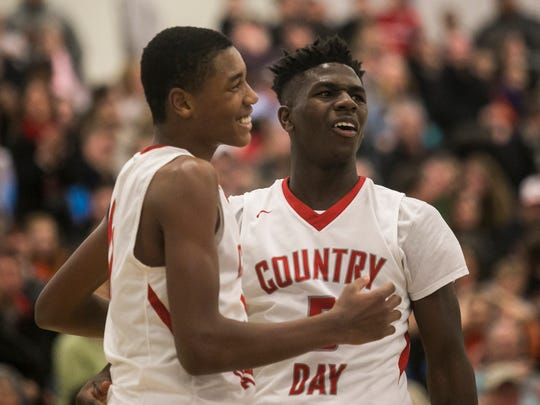 York Country Day's Jalen Gorham, left, and Jordan Ray react after Ray was fouled on a dunk attempt, during the fourth quarter of a PIAA Class 1A tournament first-round game against Jenkintown Friday, March 10, 2017, at West York Area High School. York Country Day won 67-58. Amanda J. Cain photo