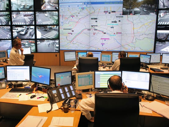 Police officers work at Paris Prefecture control room