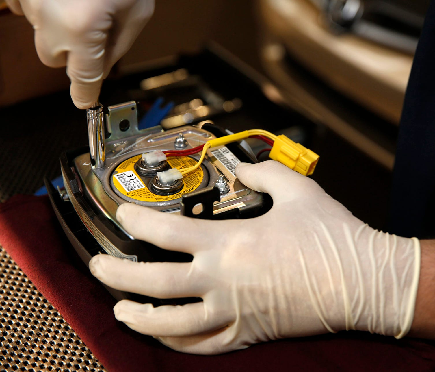 A new air bag inflator is installed on the Takata service recall of a 2005 Honda Accord LX at Suburban Honda in Farmington Hills, Mich., in this May 2015 file photo.